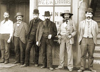 Men In Front of Bar.png