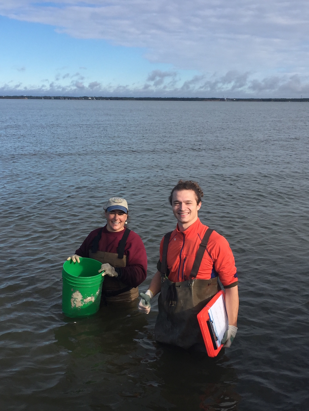 Judy Haner of The Nature Conservancy and Mobile Baykeeper Program Coordinator Cade Kistler celebrate a successful day monitoring oyster in Portersville Bay.