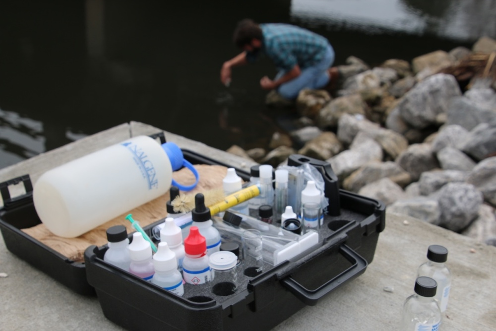 Program Director Jason Kudulis takes a water chemistry sample on Eslava Creek.