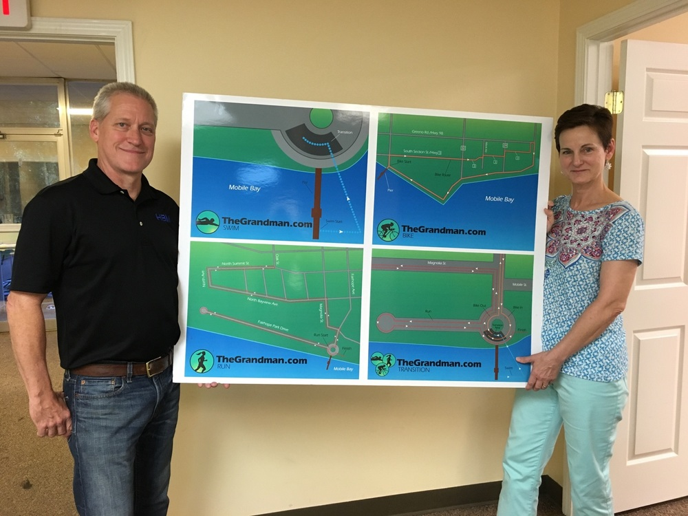 Husband and wife Terry (left) and Jennifer (right) Hartley are pictured above with the map of the Grandman race course.