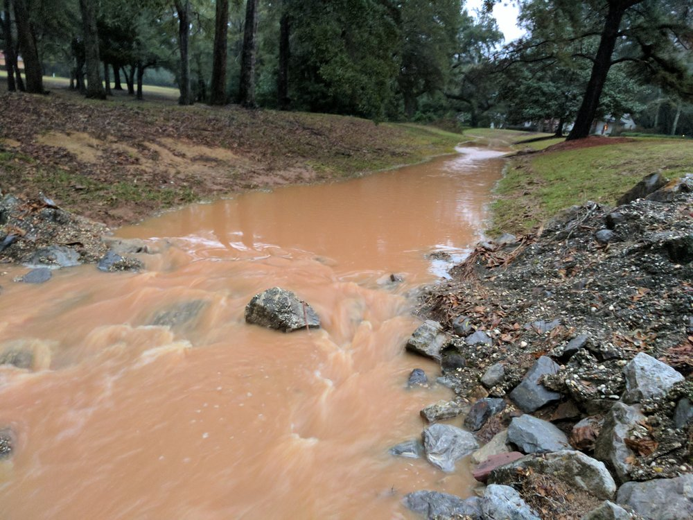 Sediment pollution in Point Clear Creek flows through Fairhope neighborhoods.