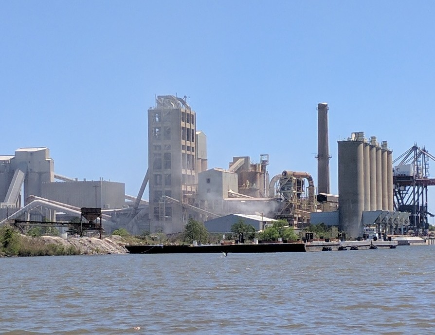 Particulate matter leaves an industrial facility on the Theodore Industrial Canal.