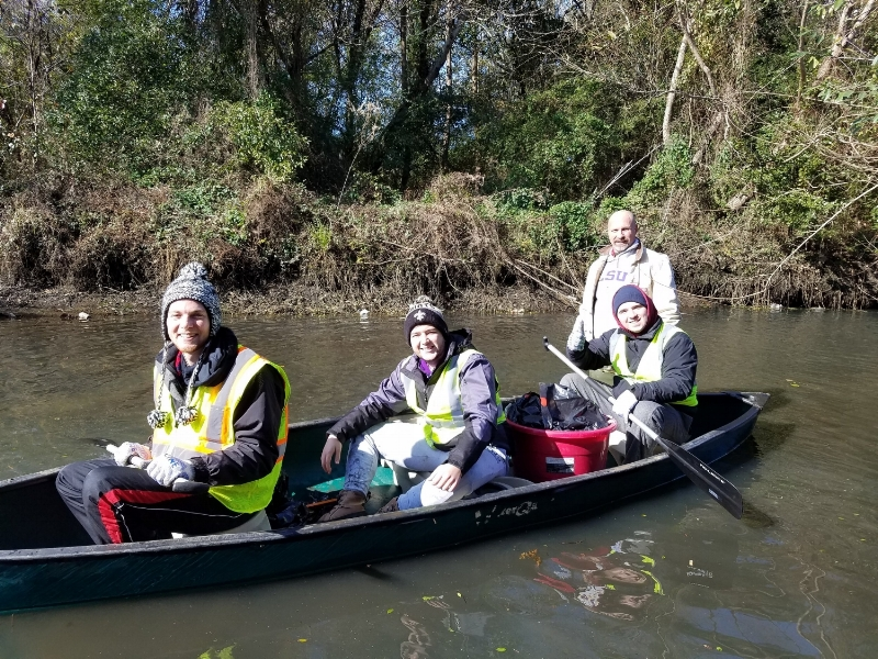 Volunteers on the water at the One Mile Creek site.