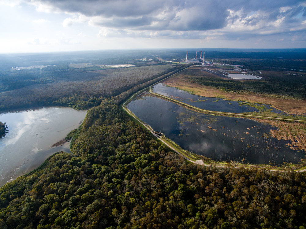 Above:  Alabama Power's Plant Barry stores 21 million tons of toxic coal ash in a 600-acre pond adjacent to the Mobile River in the Mobile-Tensaw Delta.