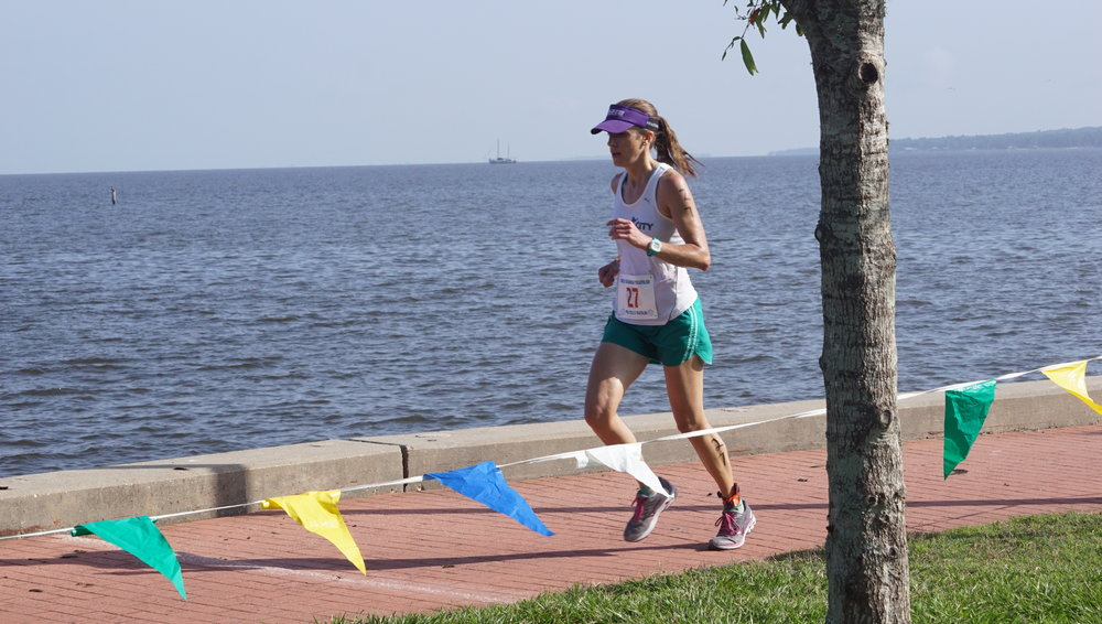 Woman running by bay 2.JPG