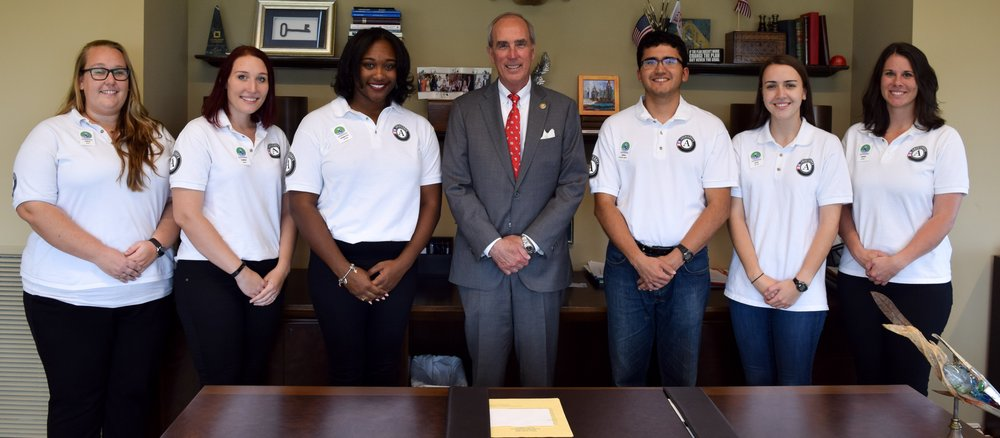 Above: 2017-2018 AmeriCorps Members spend time with Mayor Sandy Stimpson on their National Day of Service. L to R: Lesie Revel, Karrie Quirin, Angelica Howard, Mayor Stimpson, Diego Calderon-Arrieta, Ellie Mallon, Sarah Hogan.