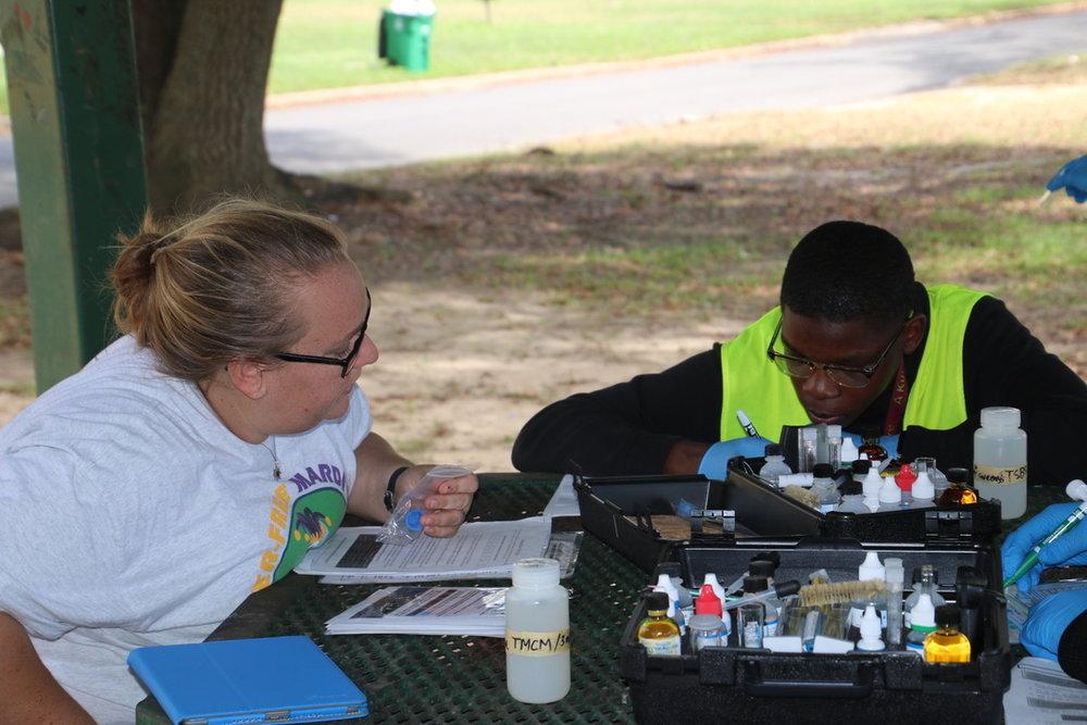 Leslie Helping Student.jpg