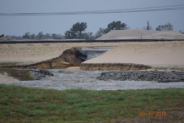 Coal ash pours out of Duke Energy's L.V. Sutton ash pond in North Carolina. Photo: Kemp Burdette - Cape Fear Riverkeeper