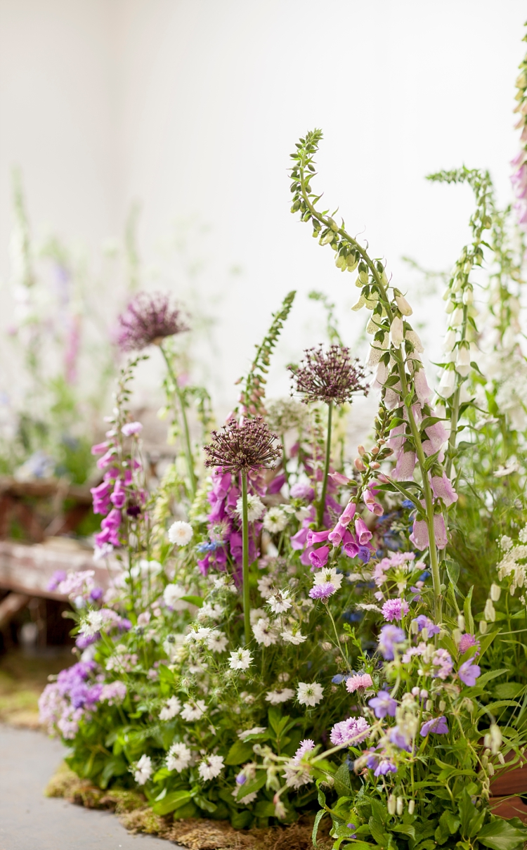 Jennifer Pinder rustic bench nestled in a meadow setting for British Flowers Week 2017 by New Covent Garden Flower Market