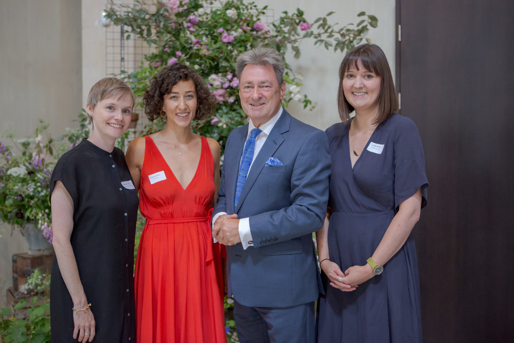 Joint winners Camila Klich and Marianne Mogendorff of Wolves Lane Flower Company and Charlotte Smithson of Festoon, with Garden Museum trustee Alan Titchmarsh. Photo: Garden Museum/Graham Lacdao.