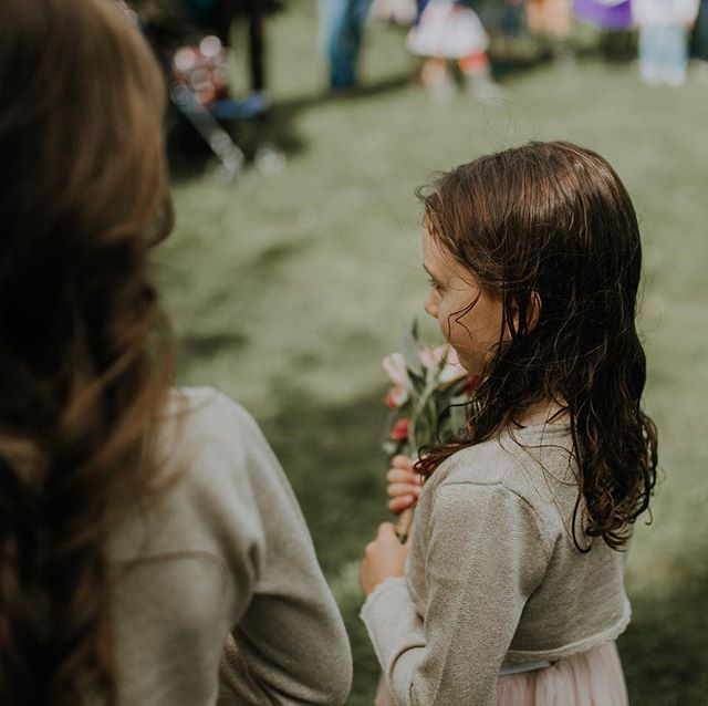 Sweet Charly watching Laura & Ric's gorgeous meadow elopement, holding her flowers tight.