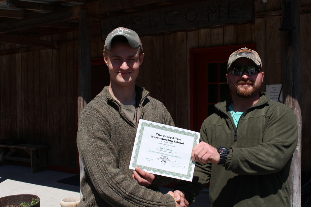 Levi Wittkopp with Link Casey Instructor Owner, Casey & Son Horseshoeing School at right 3.30.14 webb size.jpg