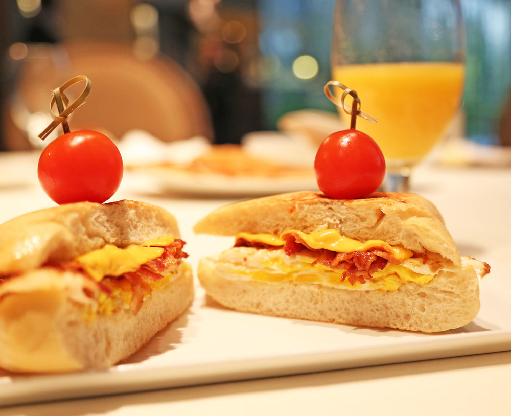Marie Gabrielle's Breakfast Sandwich made with egg, bacon and cheese on a fresh bakery roll.