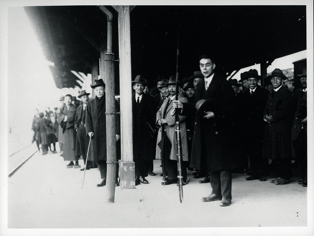 The Reverend Richards holding a  yumi  (long bow) leaving Yamaguchi station in 1927.