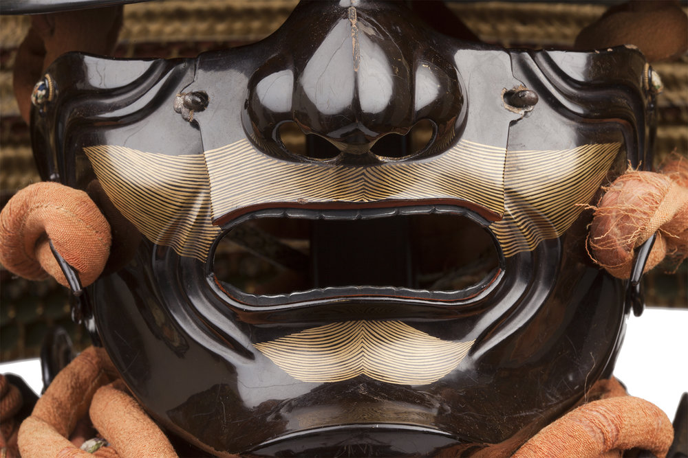 Detail of   menpō  (half mask)  ,  mid Edo period, 18th century, iron, gold, lacquer