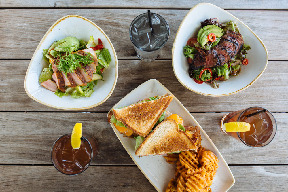 The new summer lunch lineup at Happiest Hour debuts with new salads and more.