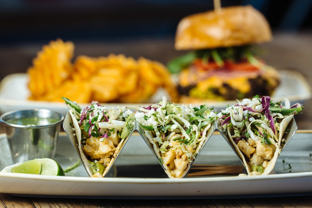 Happiest Hour's new summer lunch lineup adds even more selections of light and fresh fare. The Fish Tacos and Veggie Burger are a pair of features on Happiest Hour's main menu.