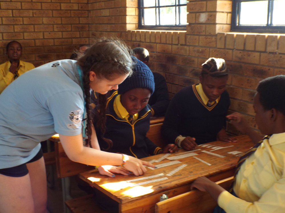 Education: Students from St. Mary's school and Mnyakanya High School working and Learning Together.