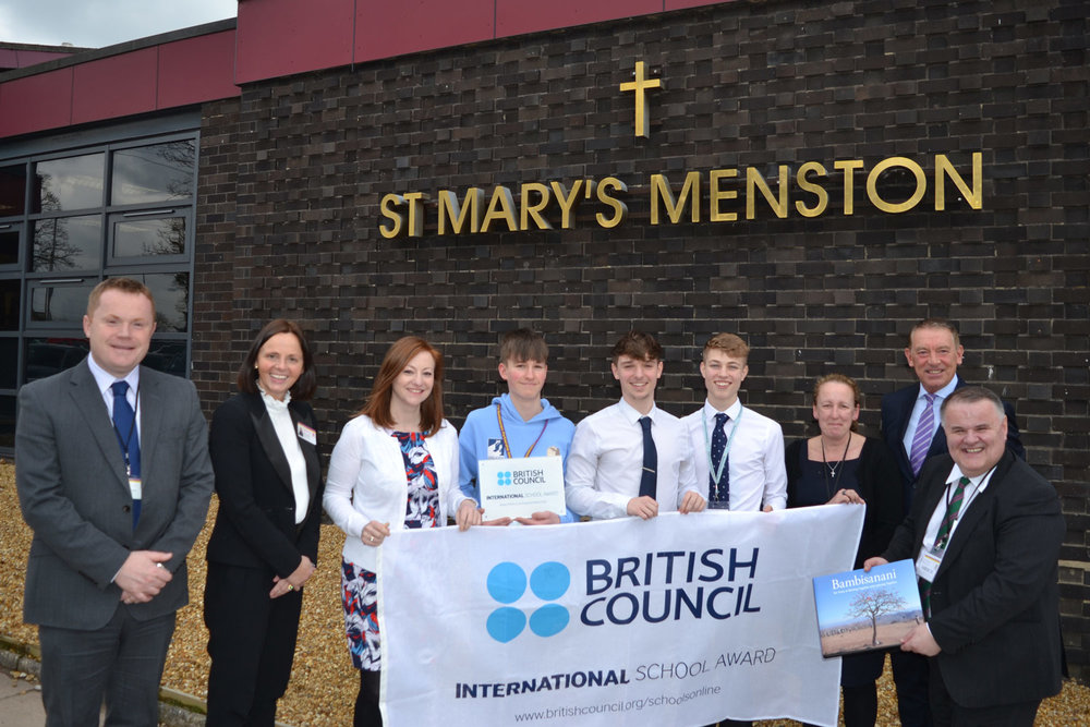Photo: LEFT TO RIGHT: Mr D Beardsley (Headteacher), Mrs C Chattoe, Miss D Neale, Tadhg Collins, Laurence Patterson, Ewan Copsey, Mrs M Hayes, David Geldart (founder of the Bambisanani Partnership), Mr John Rolfe MBE