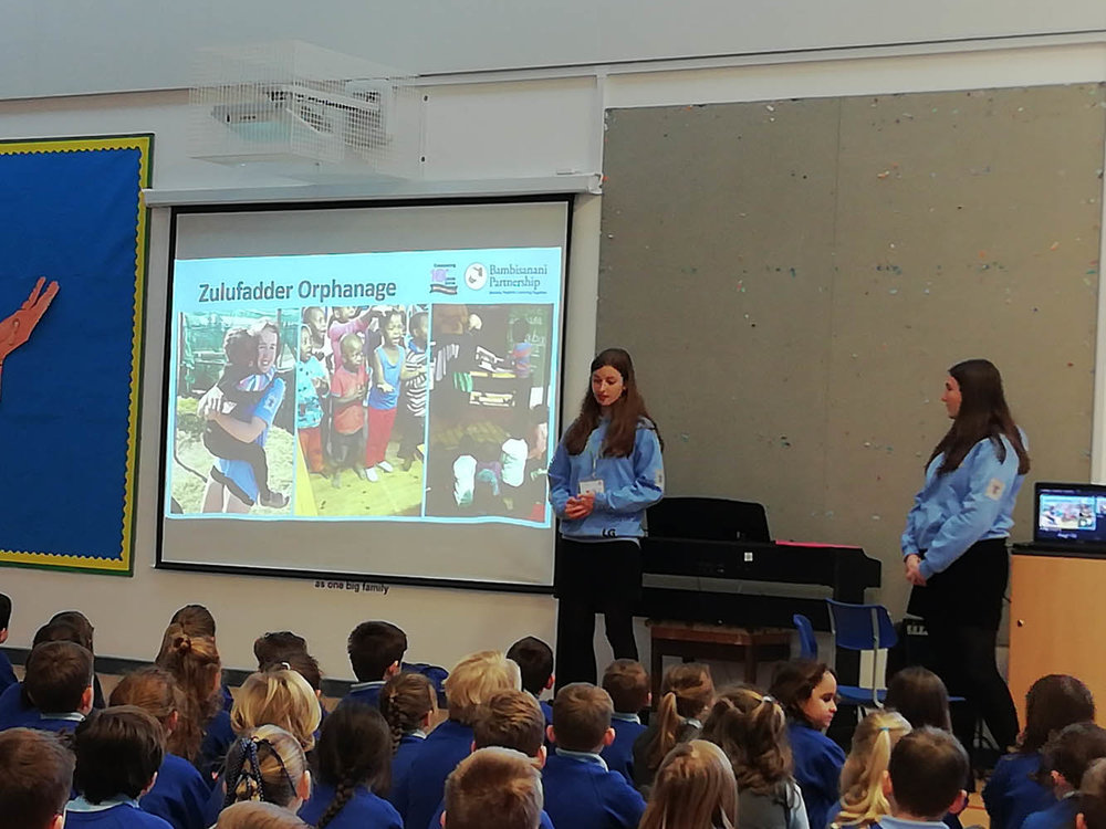 Lily Greenhalgh and Lucy Hings giving an assembly to Ss. Peter and Paul, Yeadon
