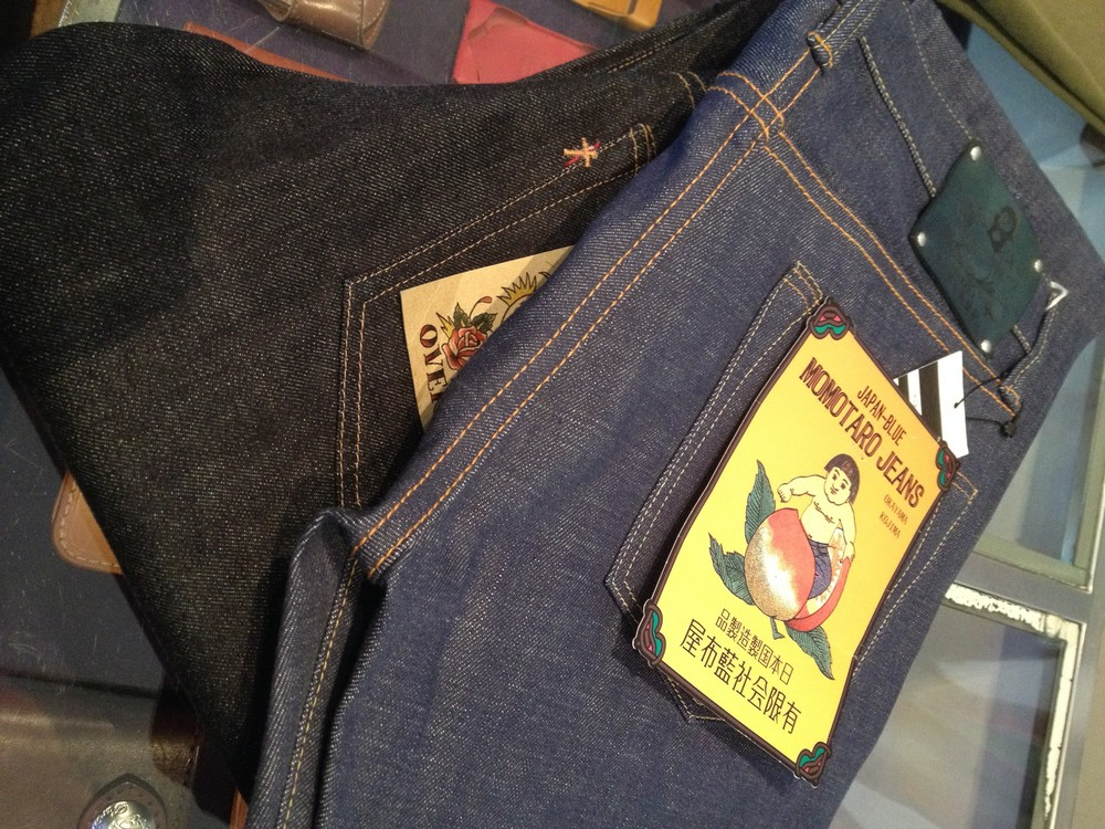 The jeans on top are dyed with natural indigo as opposed to the chemically made indigo used on the denim below.