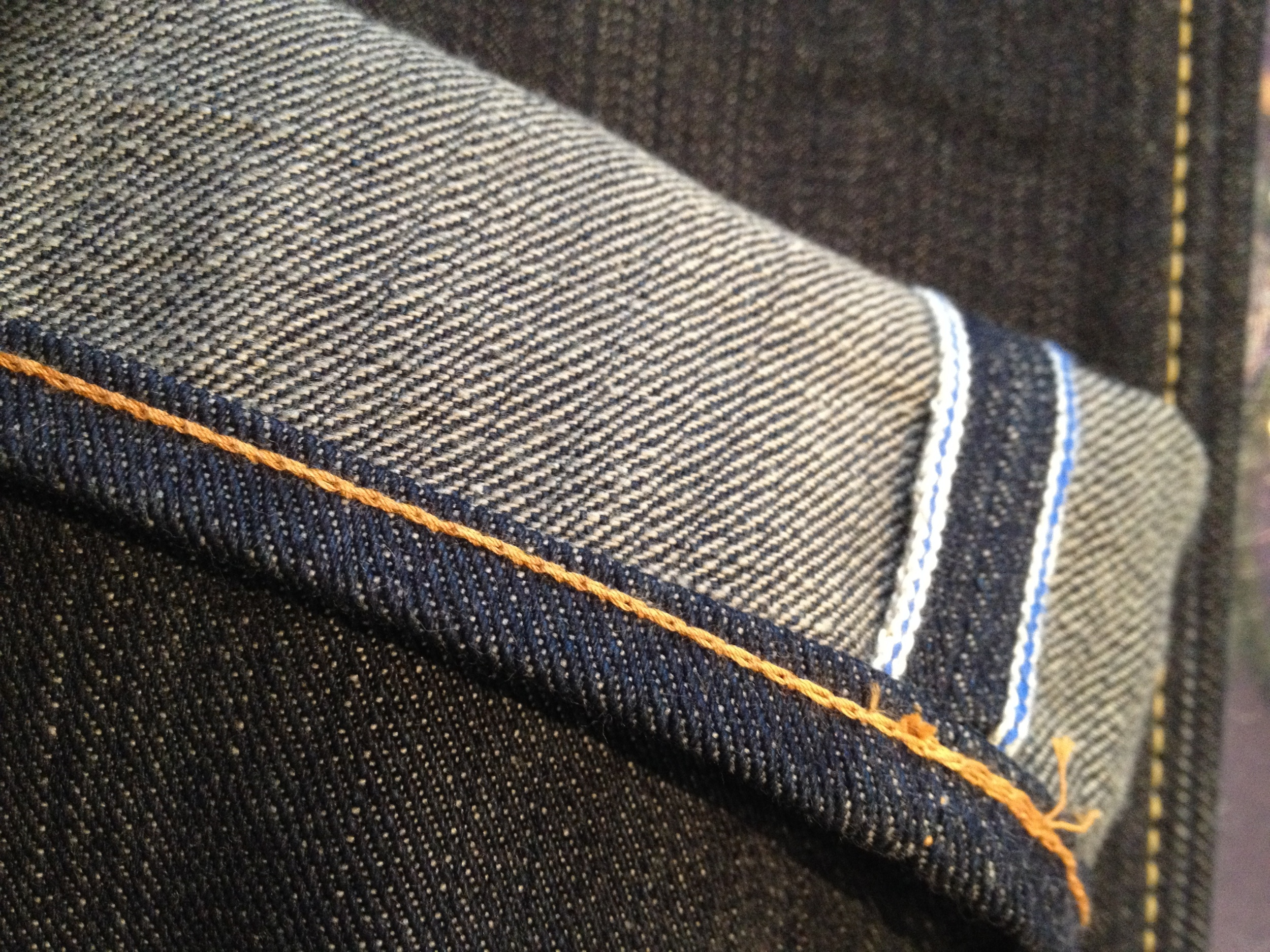 Selvage stitching on jeans—indication that the denim was made on a single loom.