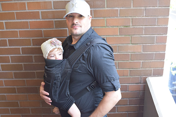Babywearing his 1-year-old in an Onya SSC