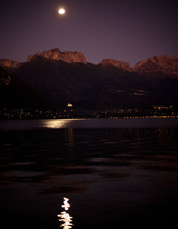 full moon rises over Lac d'Annecy
