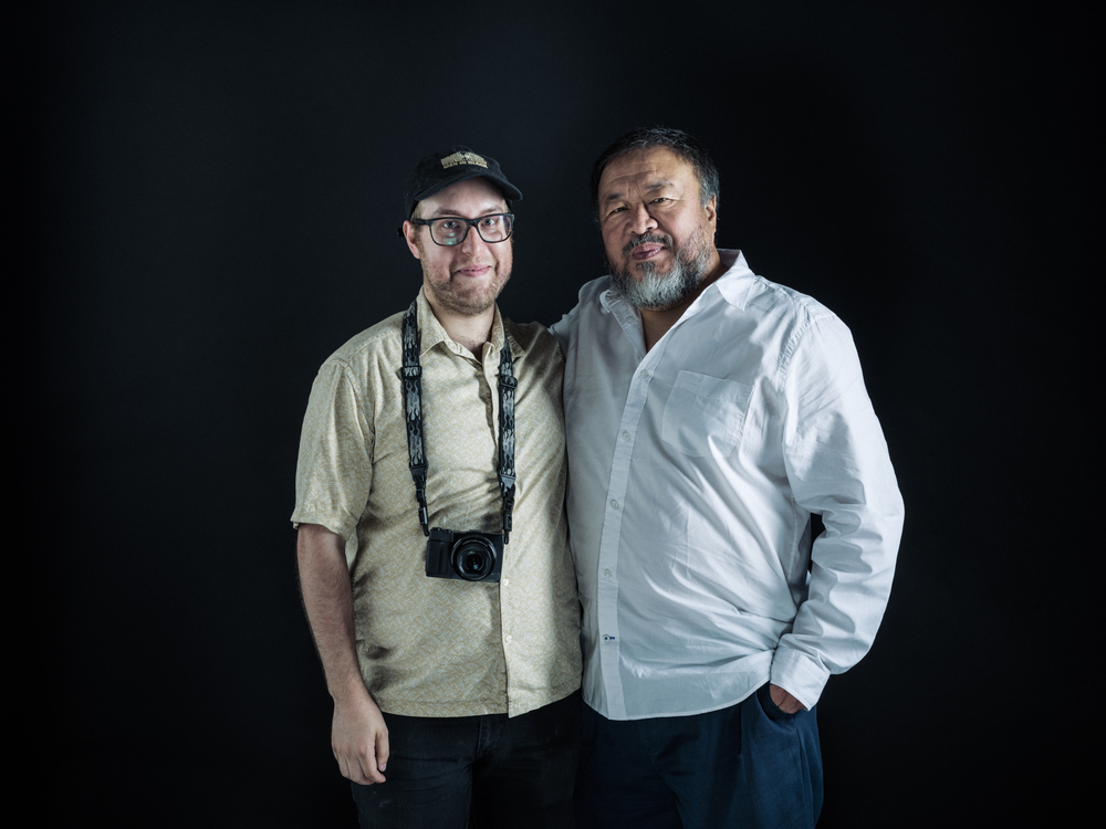 Portrait of Travis Mitzel (left) with artist Ai WeiWei. Photo by Chad Batka.