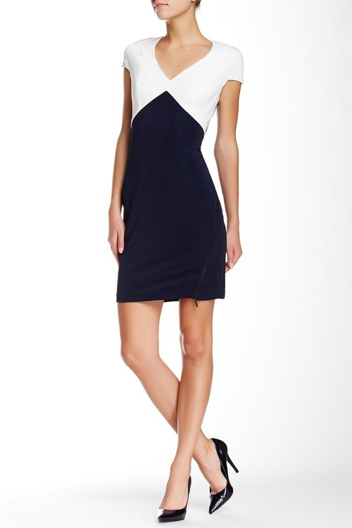Julia Jordan's  Colorblock Dress  is thoughtfully broken up at a higher place to bring attention upwards. The stark white on navy contrast highlights the upper portion of the body and diminishes the appearance of larger hips.