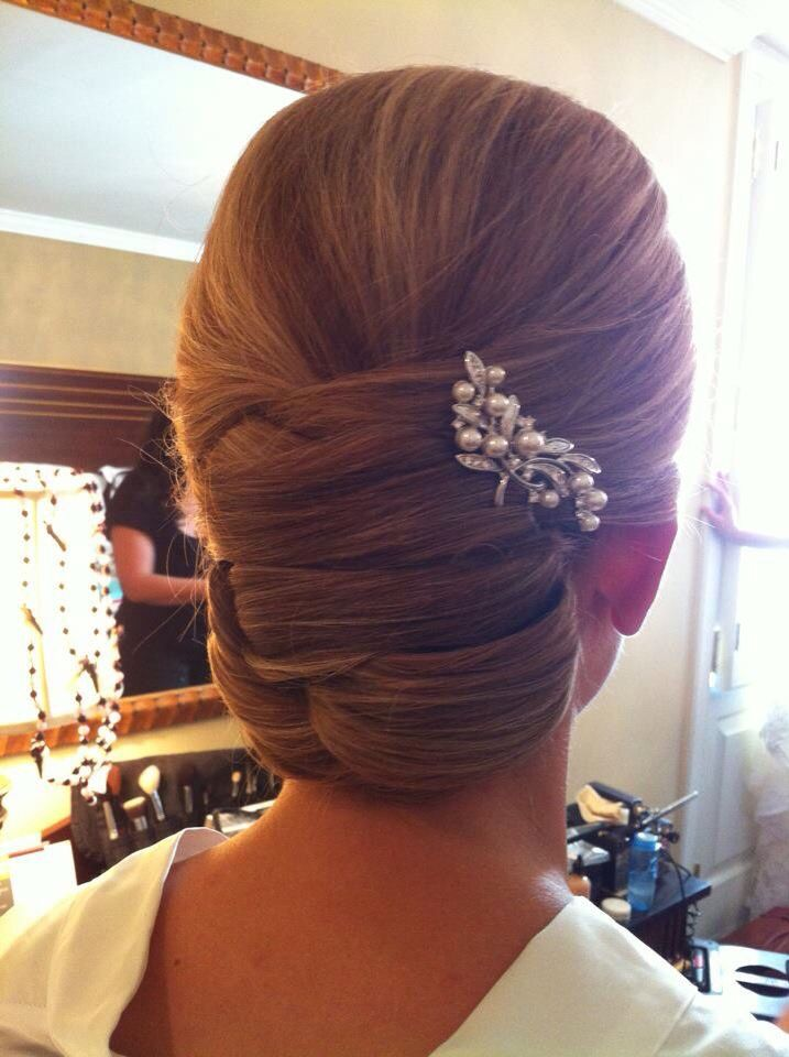"A slick and chic hairstyle for the more traditional or modest bride. This hairstyle says, ""put together."" 