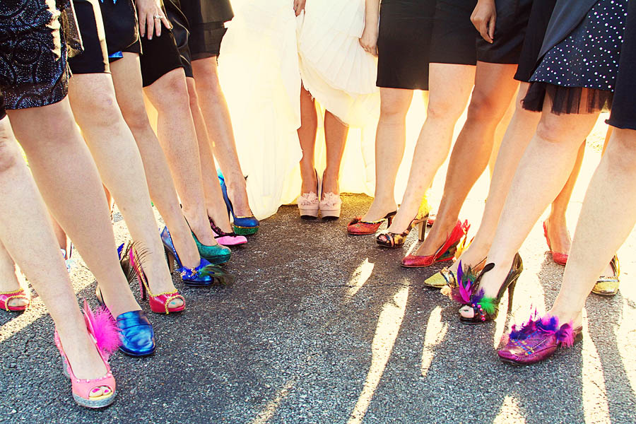 This bride DIY-ed her bridesmaids' shoes with Mardi Gras flair.  |  Photo by Crystal George via Rock n' Roll Bride