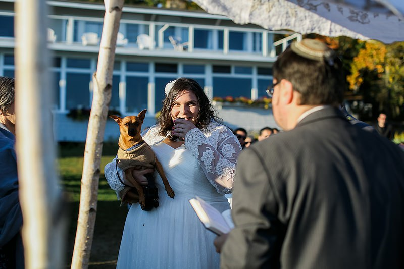 When Riley, the Min-Pin (Ring Bearer) refused to be held by the bride's stepmom and had to be snuggled up with Mom during the ceremony.  So effing sweet!  Did you notice that he's wearing a sweater?  |  Photo by  Colleen Macmillan Photography  via  Offbeat Bride