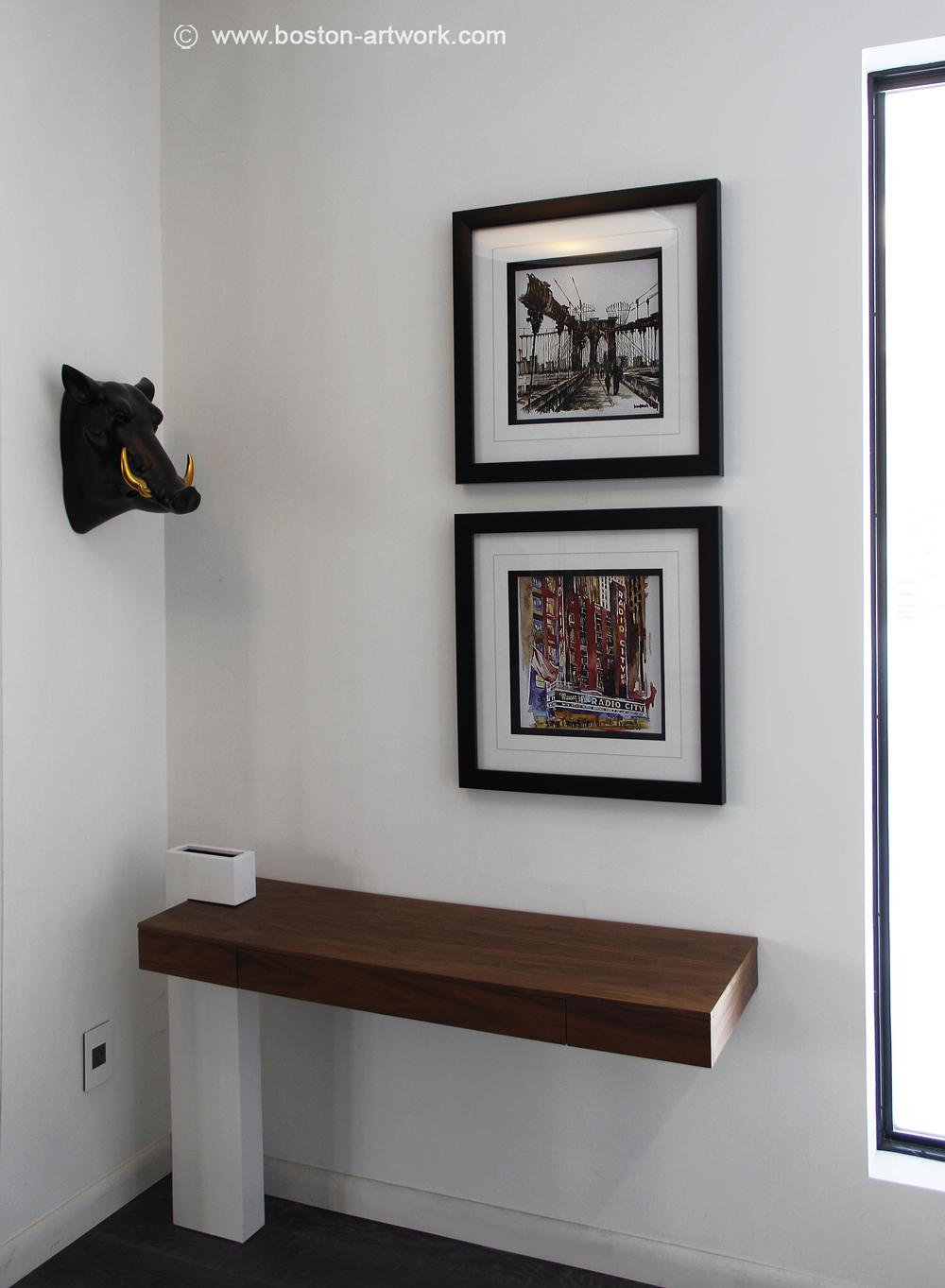 custom frames of new york art prints on our foyer