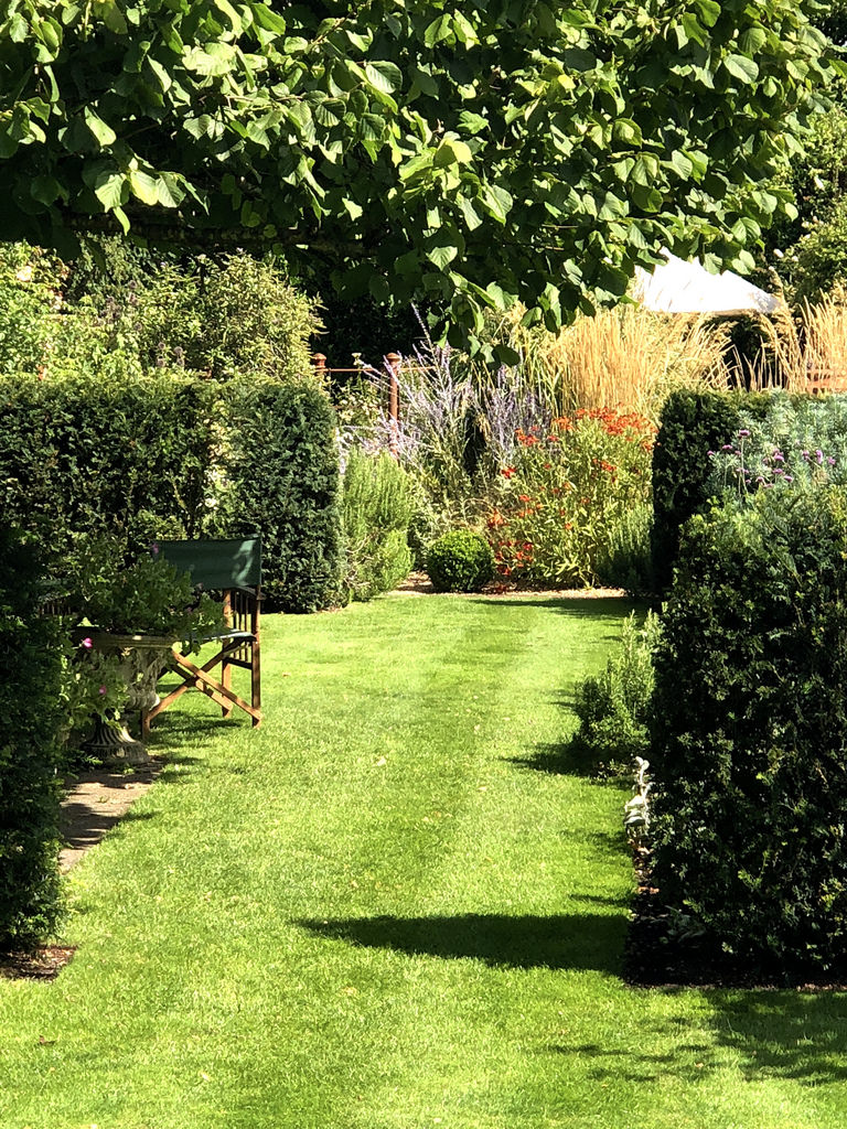 A well manicured lawn adds the finishing touch to this garden.