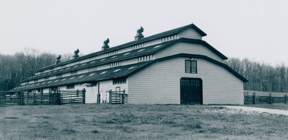 ABOVE:  Old photo of Edsel Ford barn showing light exterior and dark trim.