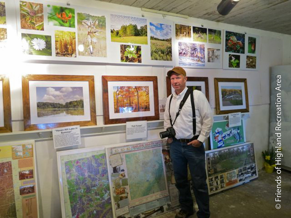 FOHRA volunteer Jay Fitzgerald and some of the Haven Hill photography on display at the Haven Hill Gate House..