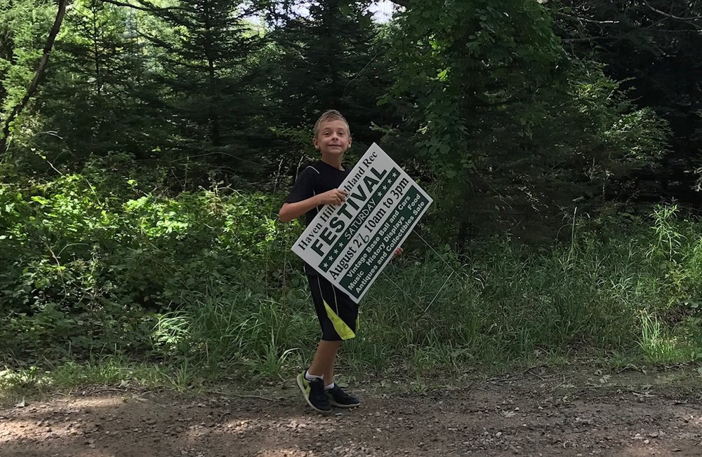 Above: The authors's son Jack Fitzgerald helping to put out this year's Haven Hill Festival signs at Highland State Recreation Area.
