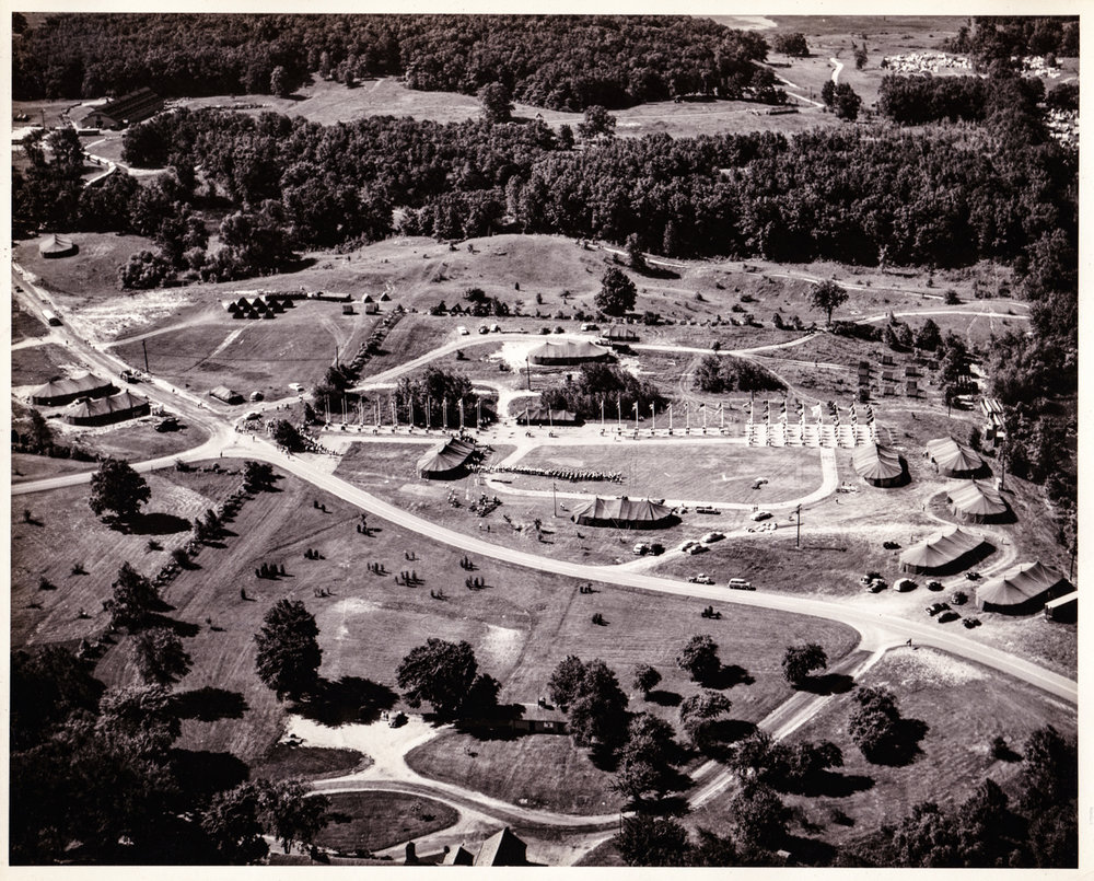 ABOVE:  An amazing aerial photograph of the 1956 Girl Scout Senior Roundup in Highland State Recreation Area. This giant daily Flag Ceremony was held in front of what its now the park's maintenance buildings complex. Photo Property FOHRA.