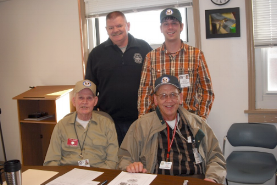 Bobby Clark (back left) poses with RACES volunteers Jason Gallimore (back right), Tom King (front left), and Dave Larsen (front right). Photo courtesy of Amy Ingram.