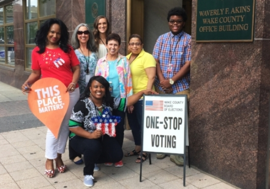 Staff outside the Board of Elections office, with Angel Perkins holding star. Photo courtesy of Angel Perkins.