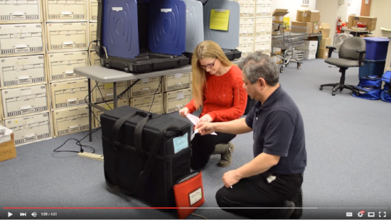 Screenshot from a Sussex County training video demonstrating how poll workers should unpack voting equipment