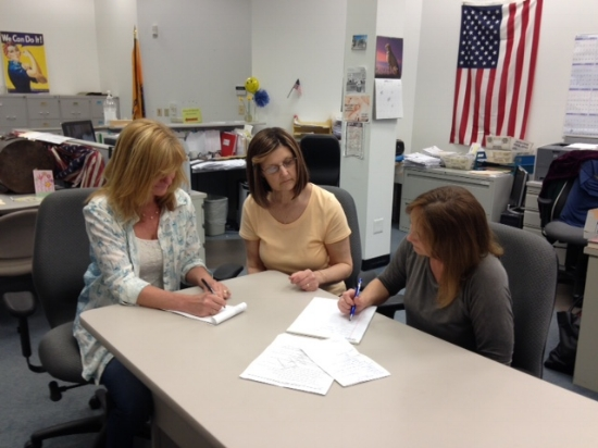 Judy Lynch, Dorleen Donahue, and Ellen Griffiths compose scripts for the videos. Photo by Marge McCabe.