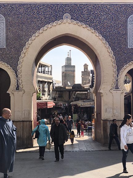 The Blue Gate entrance into the ancient Medina in Fez frames a beautiful minaret within.