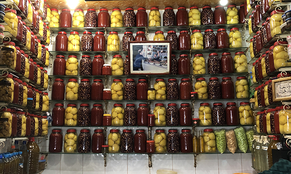 Preserved lemons, olives, peppers, and other goodies in the market.