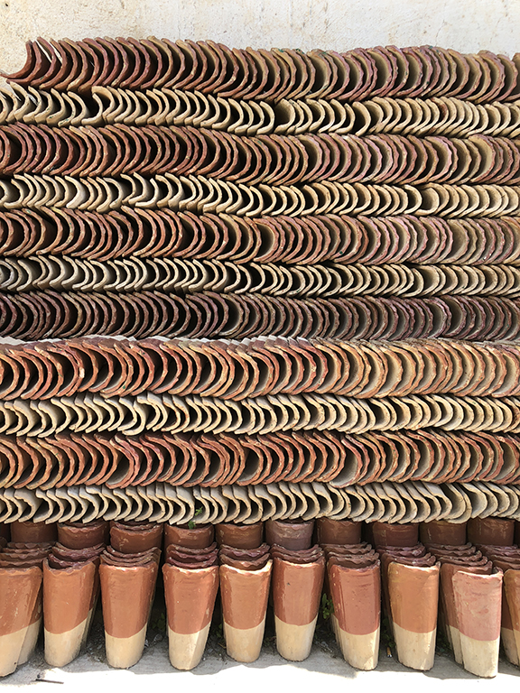 Clay roof tiles at the ceramic and mosaic workshop are available in multiple colors and sizes. The textures and colors stacked caught the attention of this photographer!