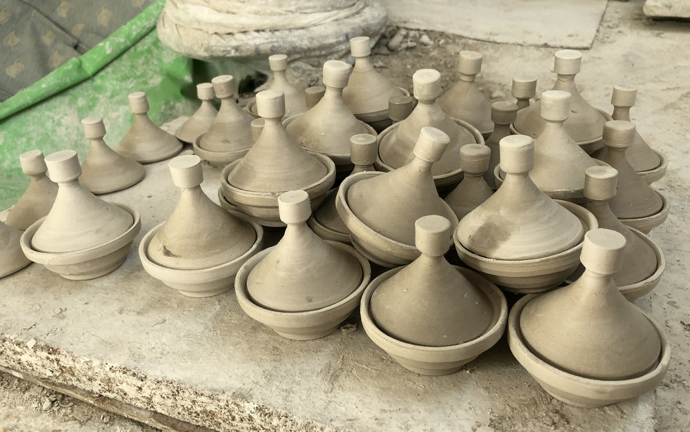 Wheel-thrown traditional clay tagine drying and being prepared for glazing. The delicious meals that will be made in these beautiful vessels will please any palette.