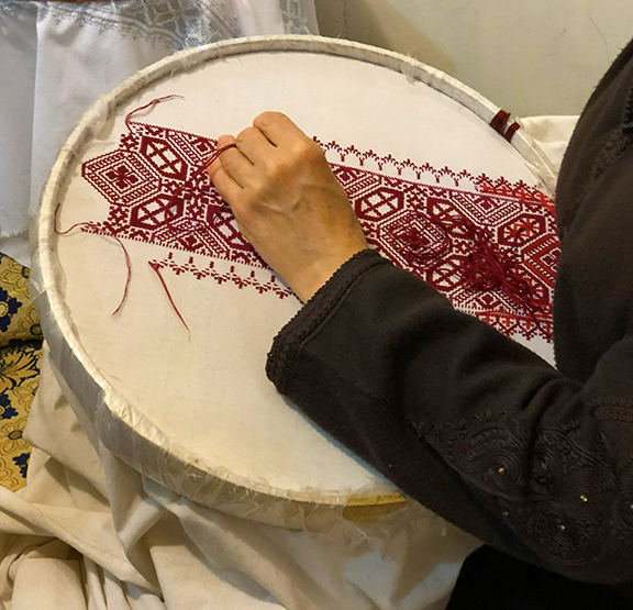 Intricate art of embroidery in traditional Islamic patterns. The detailing and tightness of the stitches is unique to this artistic style.