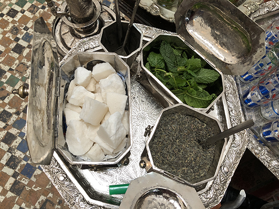 The tools of Moroccan Mint Team making, in beautiful silver vessels on a decorative silver tray.