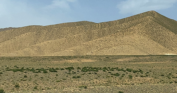 The Black Desert meets the Sahara Desert near Mezzouga, Morocco. The black is lava from volcanic activity long ago.
